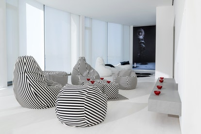 Norma Kamali's minimalist home decor collection includes cozy lounge pieces.
