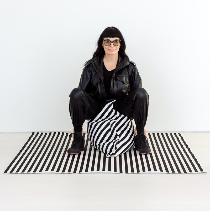 Norma Kamali designed a home collection that includes a black and white, oversized pillow.