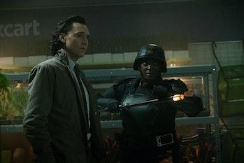 Tom Hiddleston and Wunmi Mosaku in Roxxcart store in Loki Episode 2