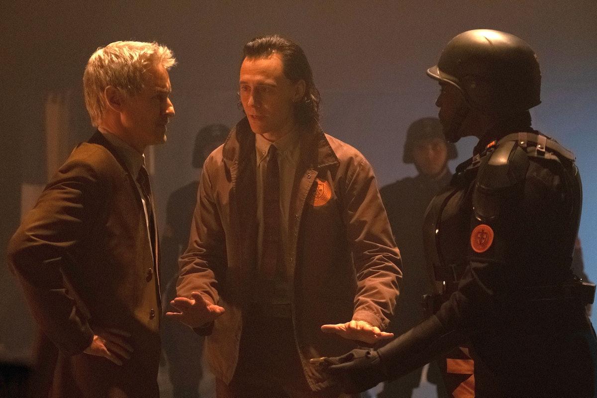Owen Wilson as Agent Mobius, Tom Hiddleston as Loki, and Wunmi Mosaku as Hunter B-15 hinting Loki in...