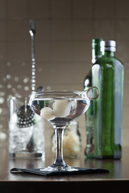 A Gibson martini is garnished with pickled pearl onions.