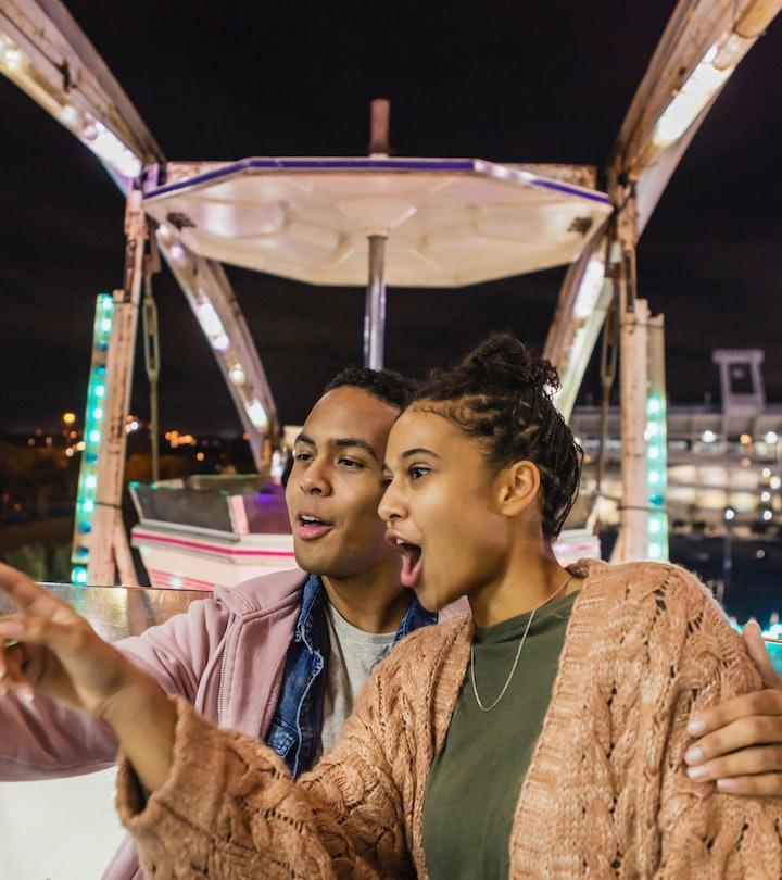 Couple at amusement park; date night