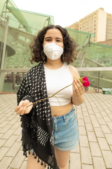 Lafi Melo holding a rose