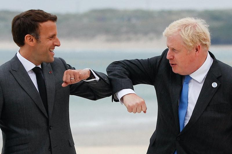 Britain's Prime Minister Boris Johnson (R) greets France's President Emmanuel Macron during the G7 ...