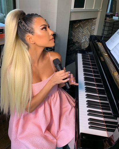 Kourtney Kardashian in costume as Ariana Grande with pink nails