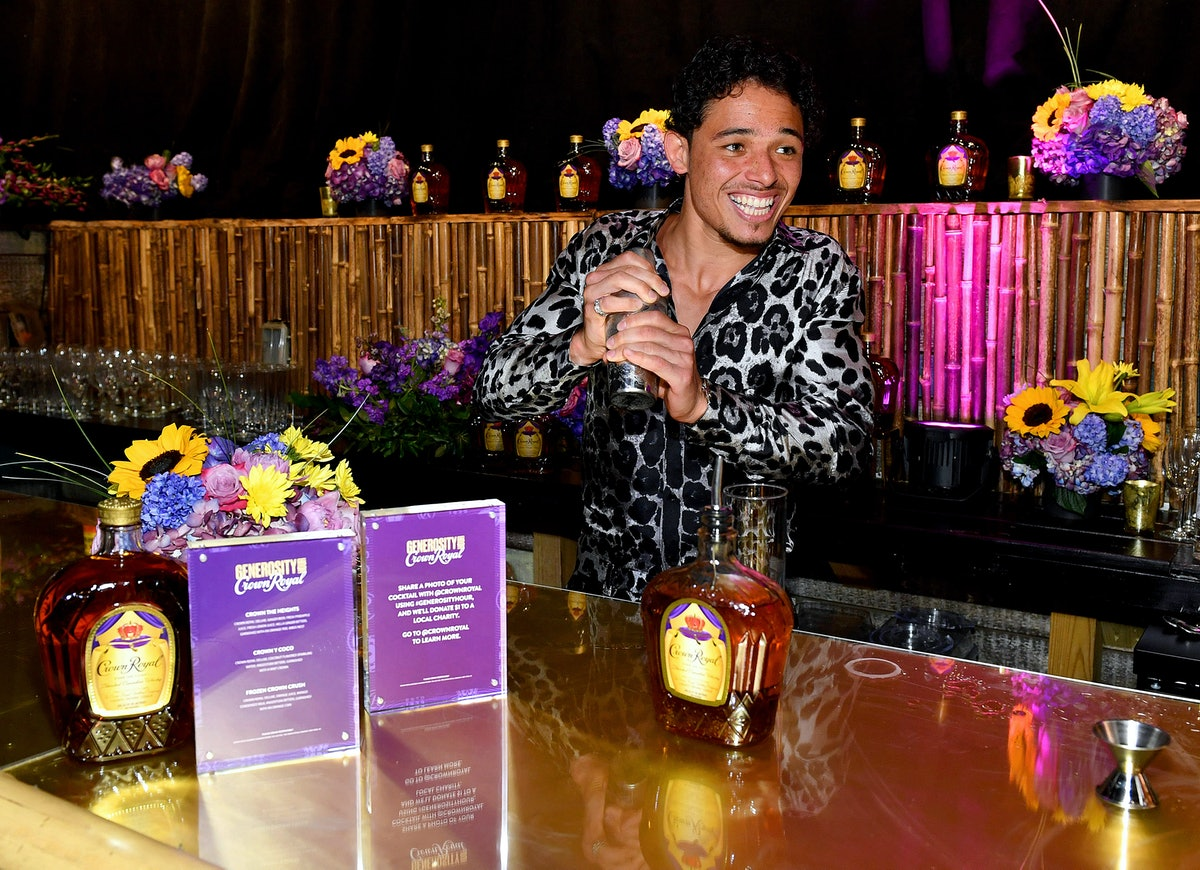 anthony ramos shaking a cocktail