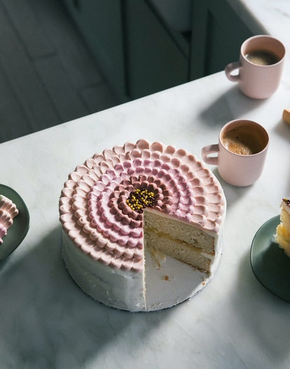 lemon coconut round cake decorated with pink petal ice cream