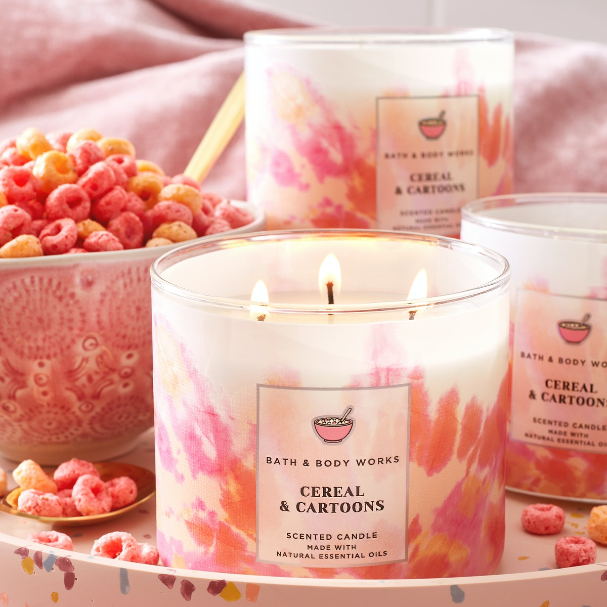 A closeup of Bath & Body Works' three-wick Cereal & Cartoon candle, introduced as part of Bath & Bod...
