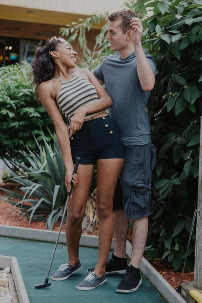 Man and woman on mini golf course