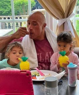 Dwayne Johnson has tea time with daughters, Tiana and Jasmine .