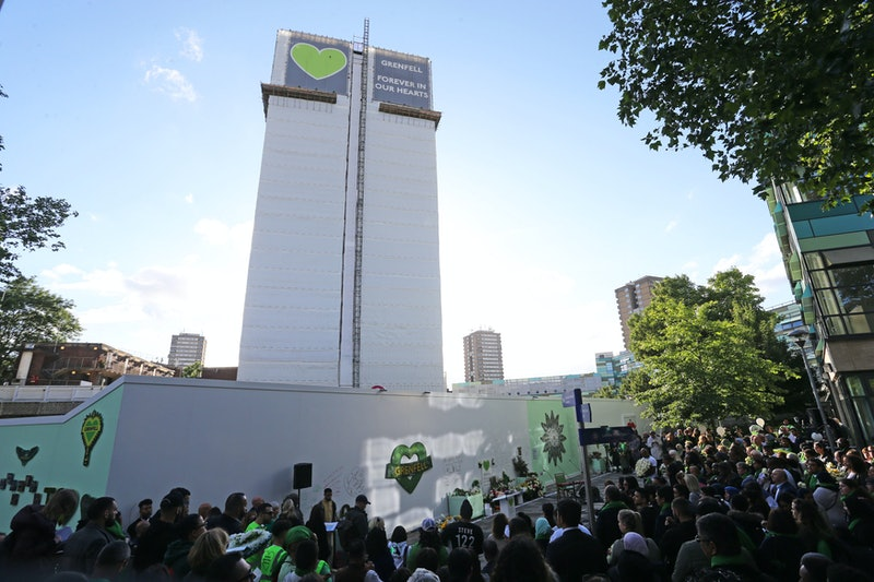 Family and friends of the 72 people who lost their lives in the Grenfell Tower block fire gather out...