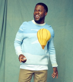 actor Kevin Hart wearing a graphic Victor Li sweater with hot air balloon print