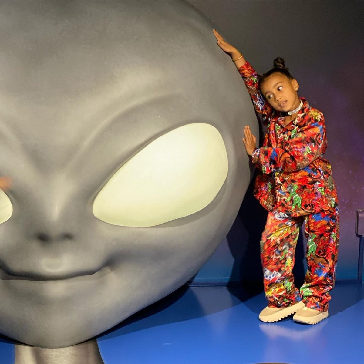 North West getting cozy with a giant alien