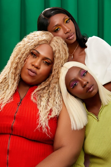 Three Waeve models wearing the wigs and posed against green backdrop