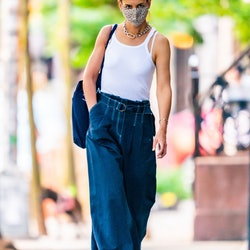 Katie Holmes wearing white tank top and wide-leg jeans in SoHo on July 31, 2020.