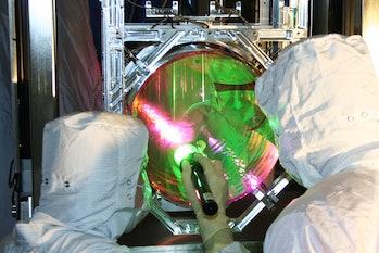 LIGO mirror cooled to near quantum ground state
