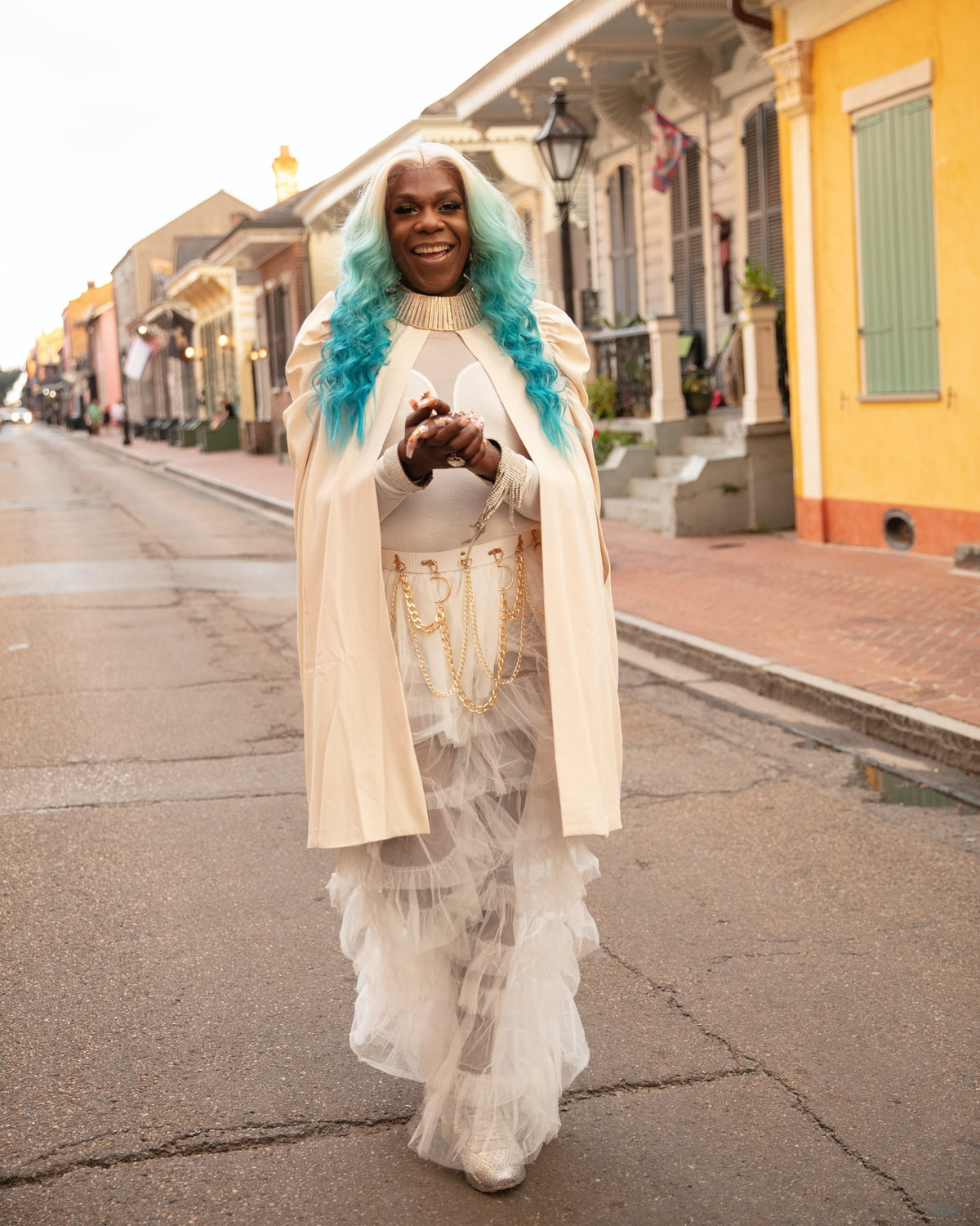 The Musician Big Freedia dressed in white and standing on the street in New Orleans