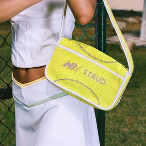 Tennis ball Tommy bag from the New Balance x STAUD collaboration.