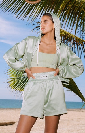 Model wearing boxer shorts and jacket from the New Balance x STAUD collaboration.