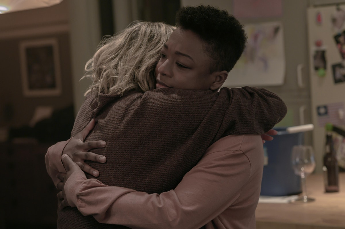 Elisabeth Moss as June and Samira Wiley as Moira embracing at the end of The Handmaid's Tale Season ...