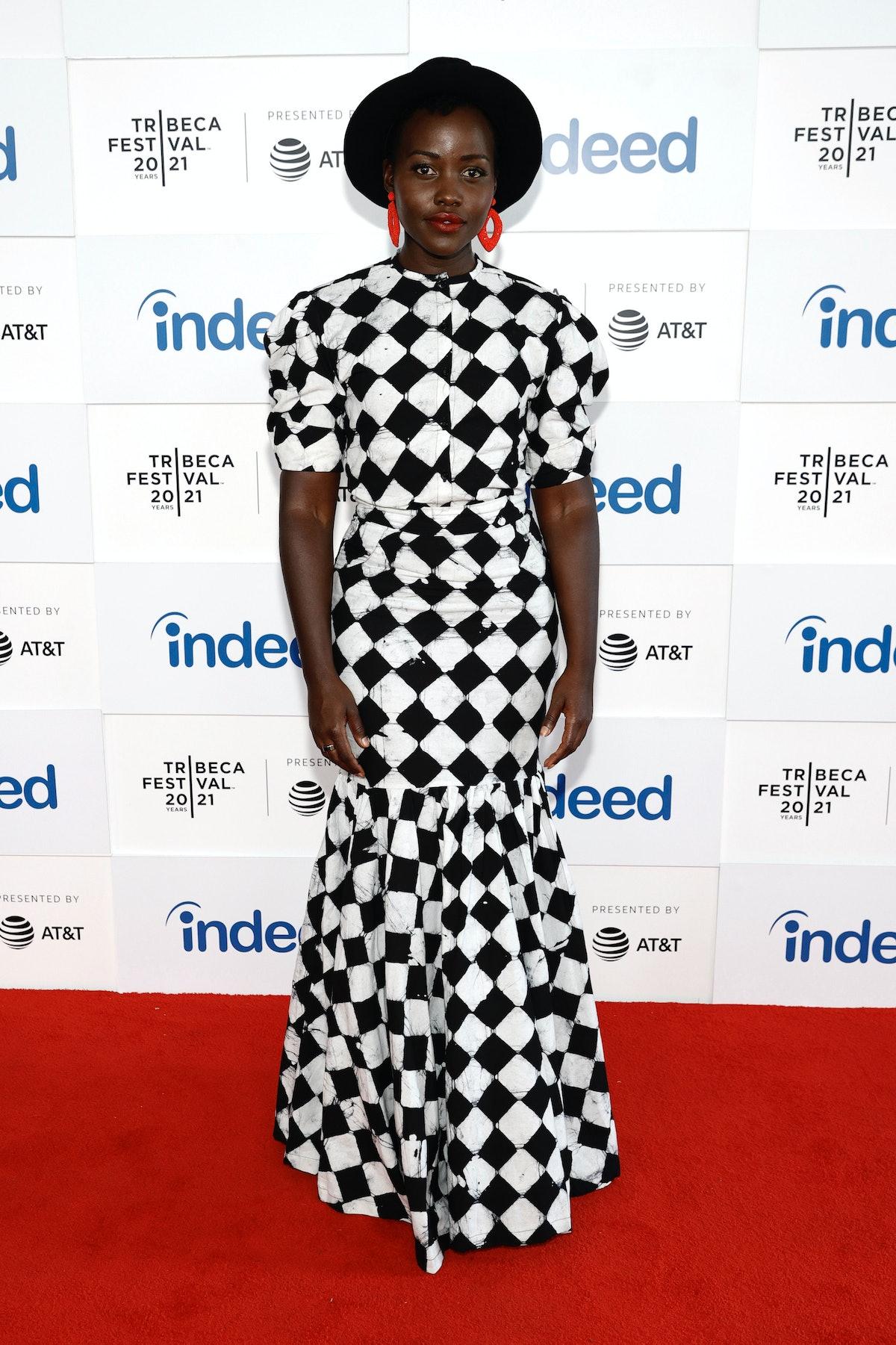 Lupita Nyong'o wearing a harlequin dress