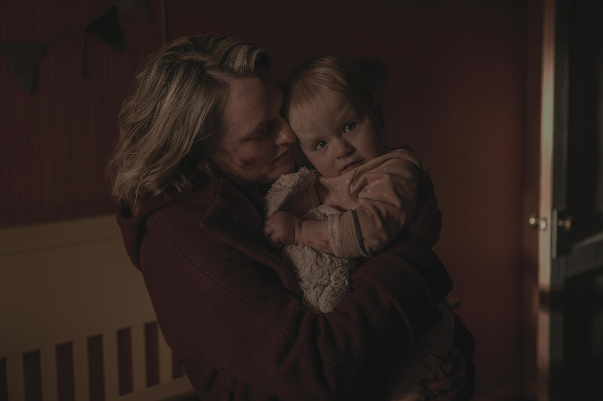 Elisabeth Moss as June hugging her daughter goodbye at the end of The Handmaid's Tale Season 4