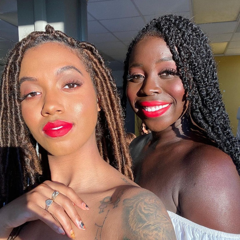 Two Lip Bar models posing with hot pink-red lipstick