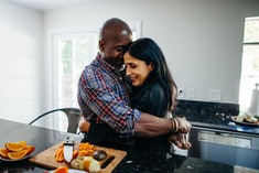 couple cuddling in the kitchen