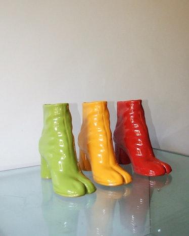 ceramic sculptures shaped like Margiela Tabi boots