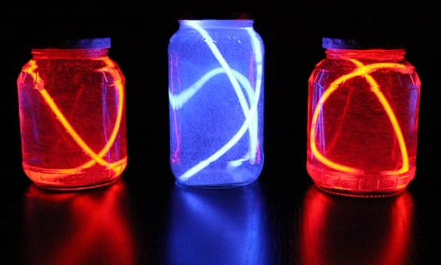 Red, white, and blue recycled table lanterns are a 4th of July craft to make with kids.