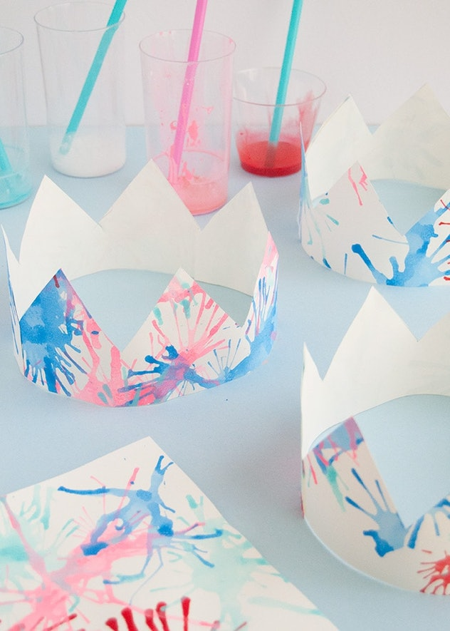 Blow paint firework crowns are a great 4th of July craft for kids.