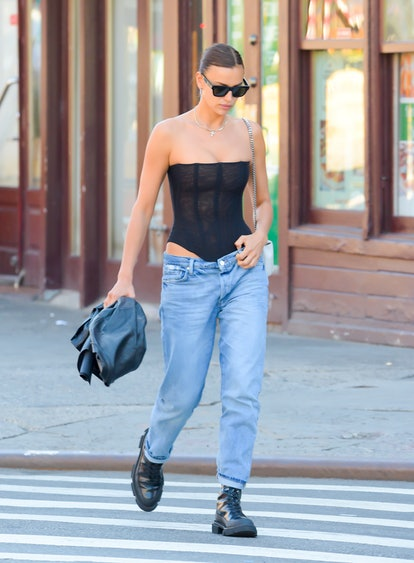 Irina Shayk wearing low-rise jeans while seen walking in soho on June 16, 2021 in New York City.