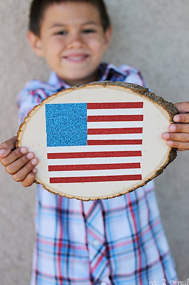 Glitter tape flags are a fun 4th of July craft for kids.