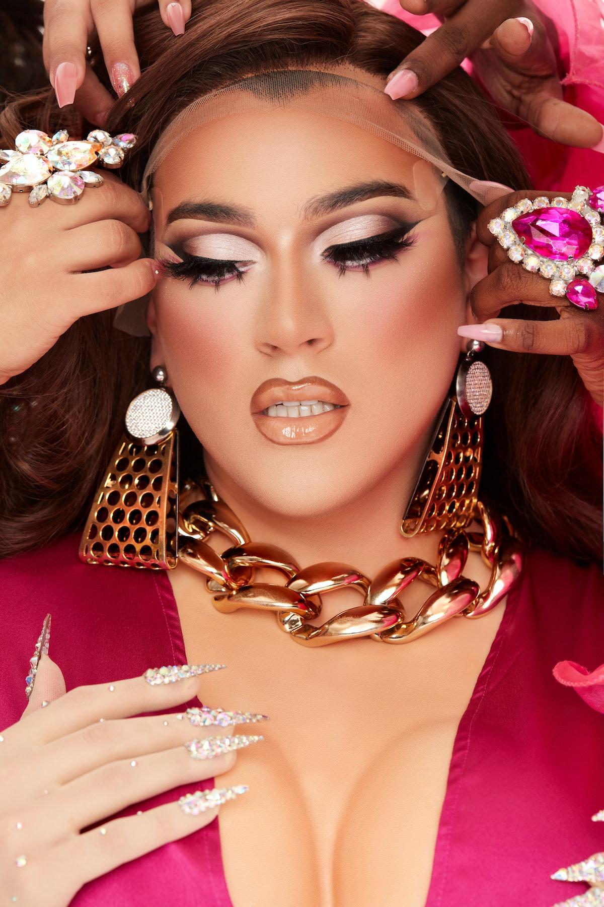 Manny Gutierrez, aka Manny MUA, posing in drag for Lunar Beauty's new Life's A Drag Facelift palette.