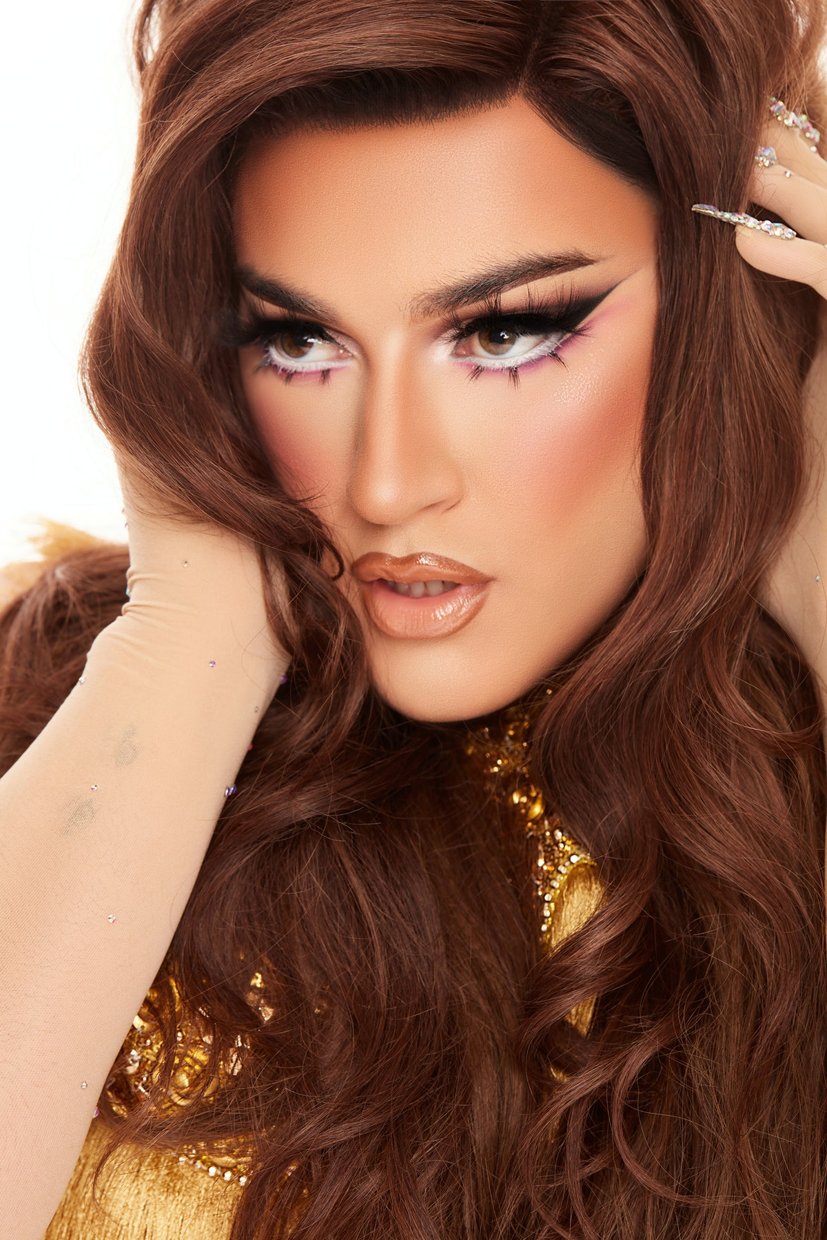 Manny Gutierrez, aka Manny MUA, poses in a gorgeous drag makeup look in promotional images for Lunar Beauty's new Life's A Drag Facelift palette.