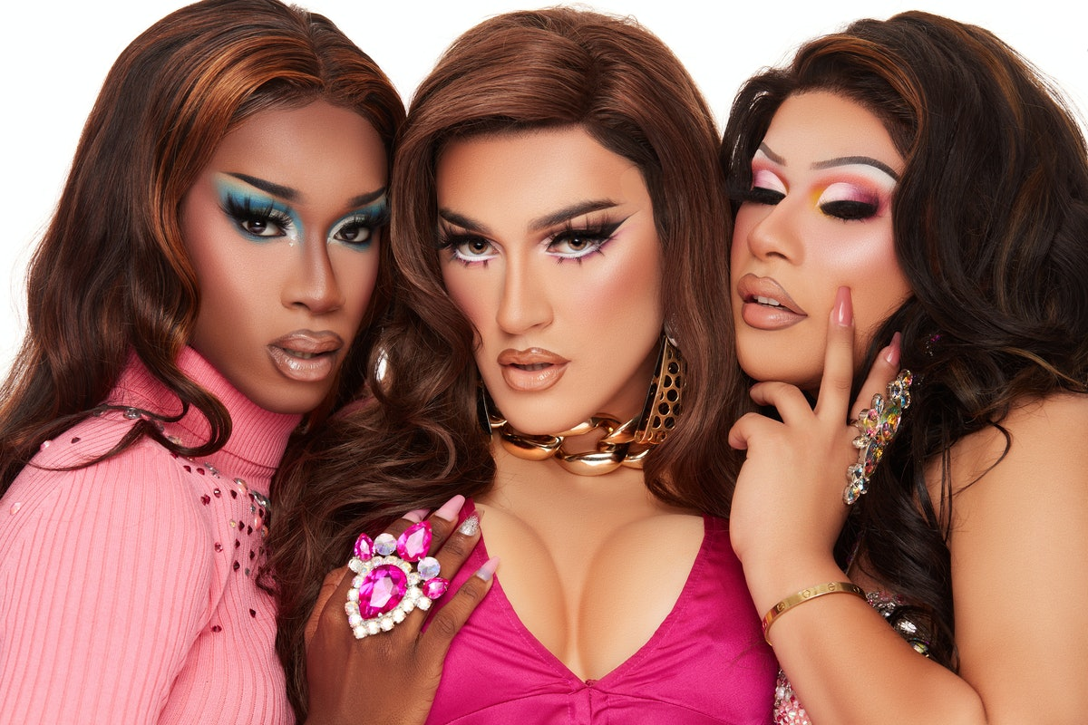 Manny Gutierrez, aka Manny MUA, poses in drag with two other drag queens for promotional images for Lunar Beauty's new Life's A Drag Facelift palette.