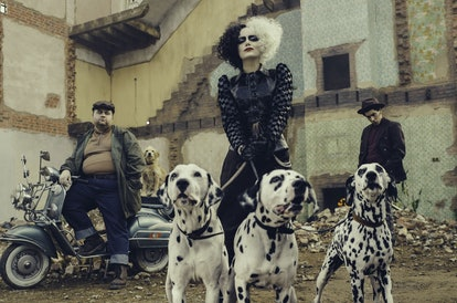 A screenshot from the movie 'Cruella,' showing Emma Stone rocking the villian's signature blonde and black hair.