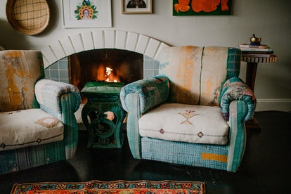 Blue fireplace tiles used in a creative home design.