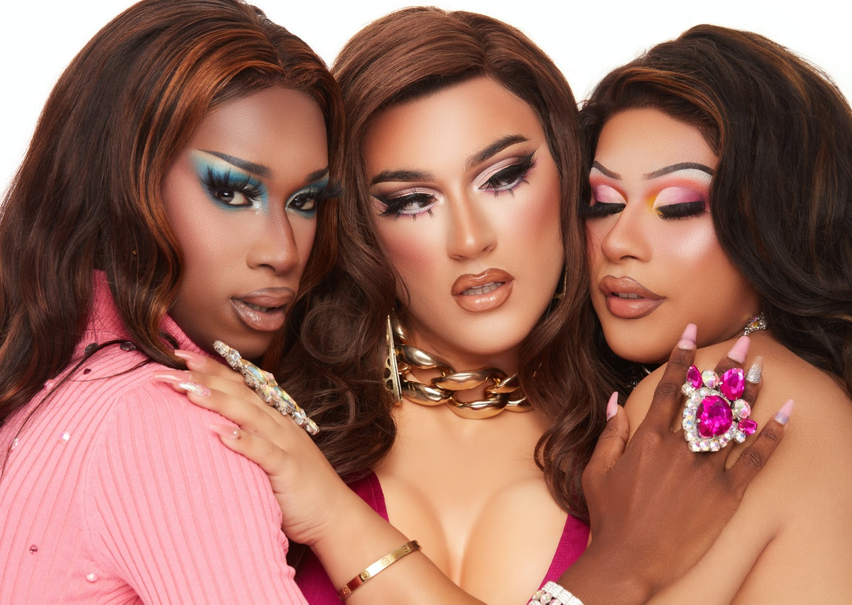 Manny Gutierrez, aka Manny MUA, poses in drag with two other drag queens for Lunar Beauty's new Life's A Drag Facelift palette.