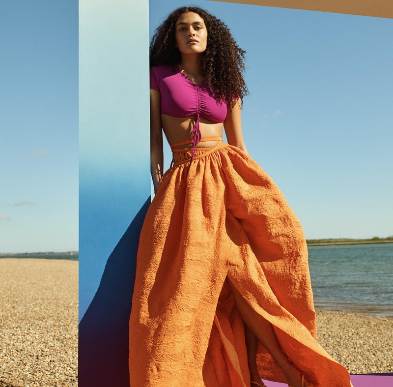 Model wearing a billowy skirt and a crop top for a Net-a-Porter campaign.