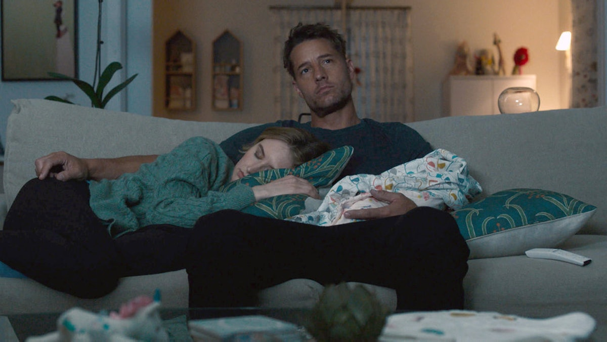 Justin Hartley and Caitlin Thompson as Kevin and Madison asleep in front of the TV