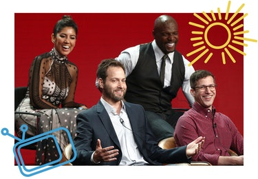 Stephanie Beatriz with Dan Goor, Andy Samberg, and Terry Crews in 2018.