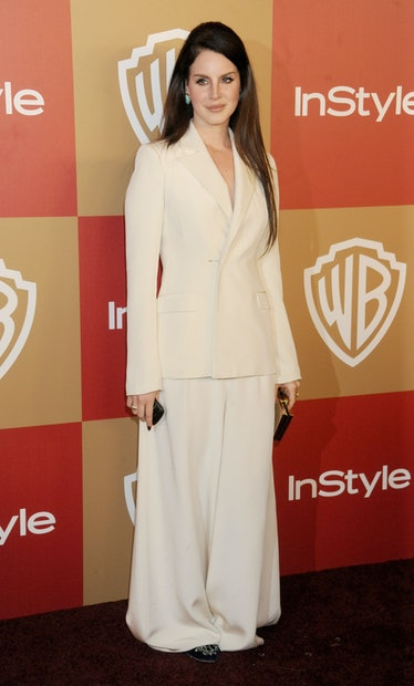 Lana Del Rey wearing a white pantsuit