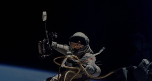 Astronaut Ed White floats tethered to his spacecraft in the first US spacewalk