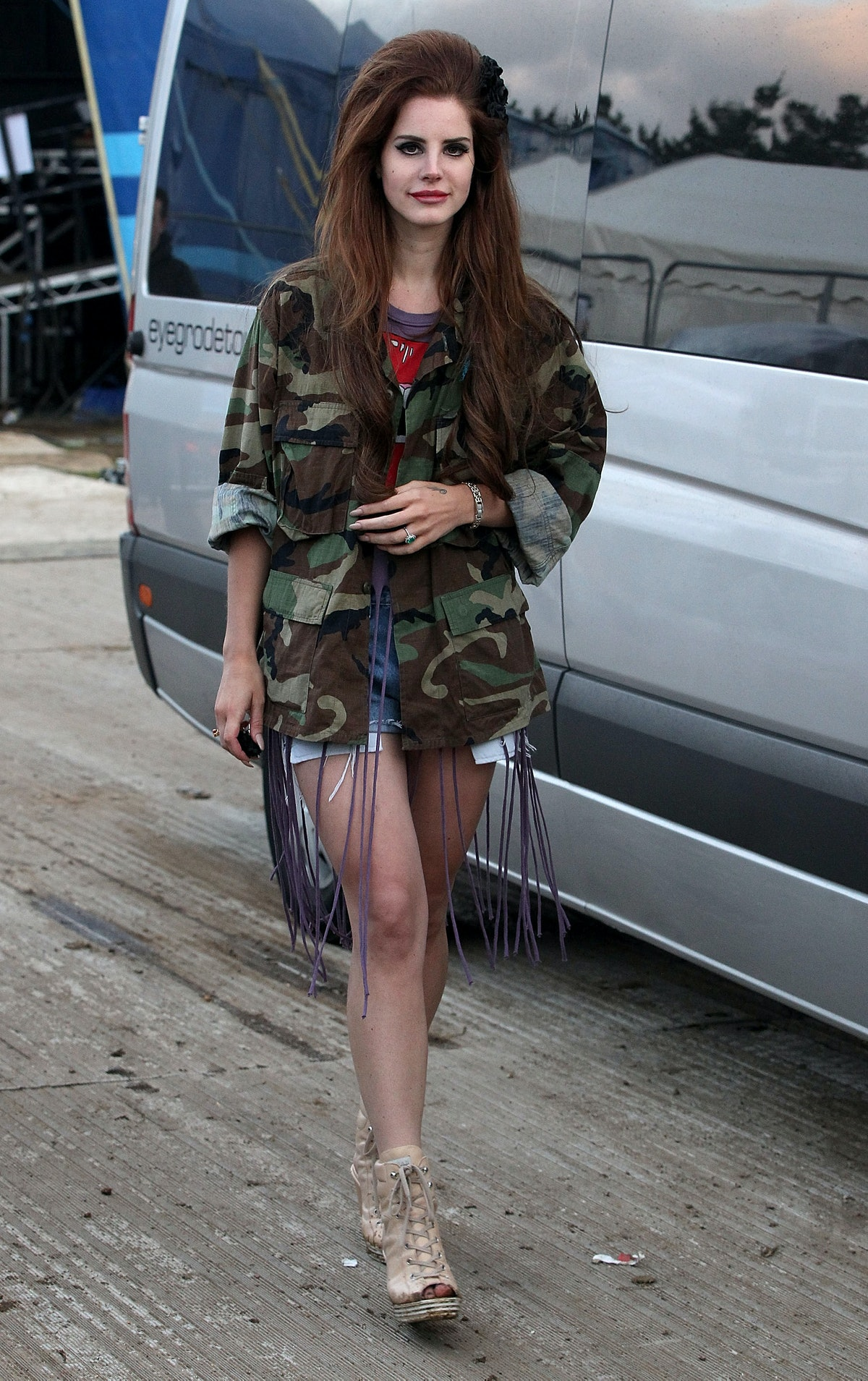 Lana Del Rey wearing a beehive and camo jacket