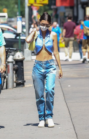 Emily Ratajkowski was seen taking a stroll while carrying a JW Pei bag on June 15, 2021 in New York ...