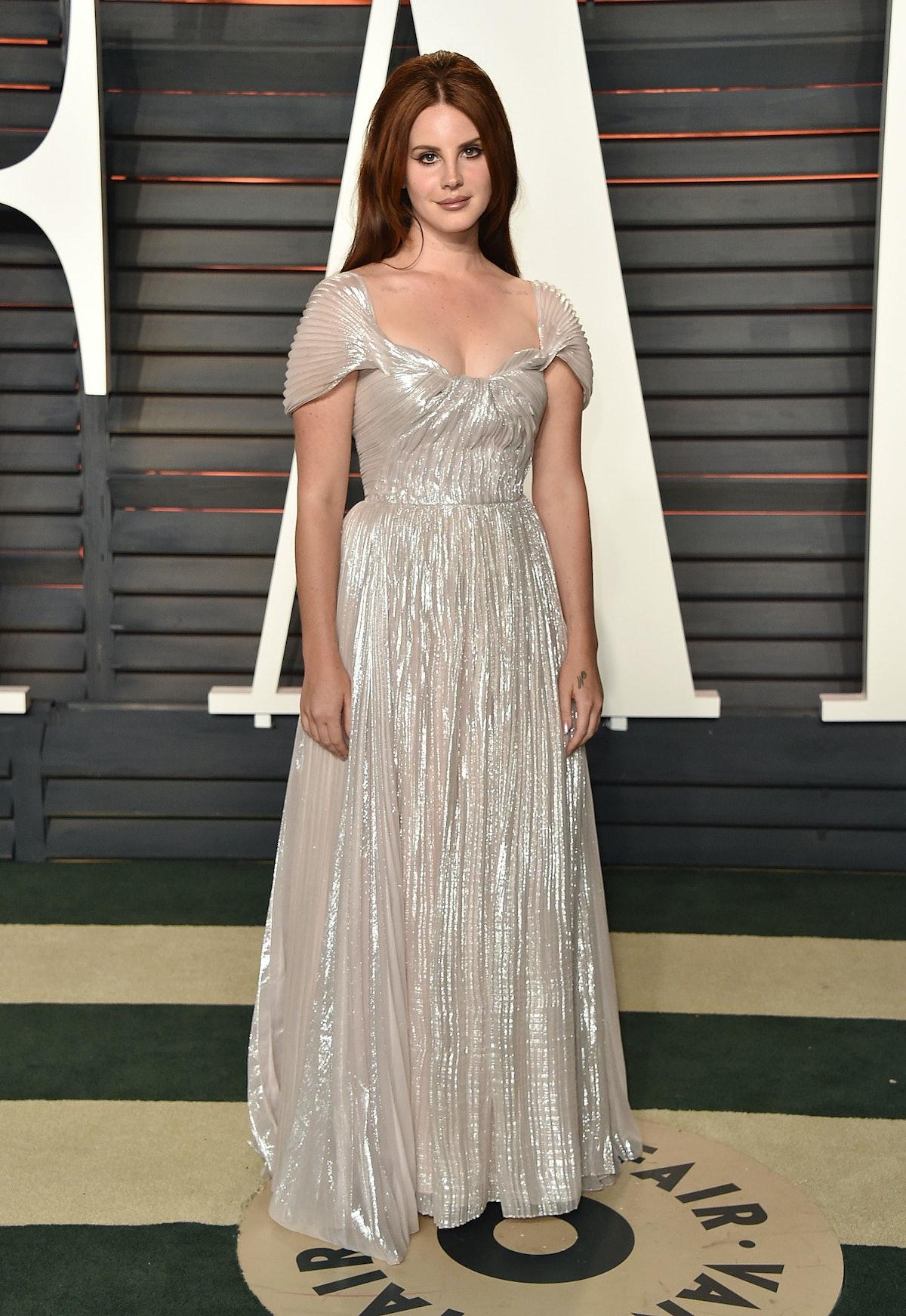 Lana Del Rey wearing a silvery dress