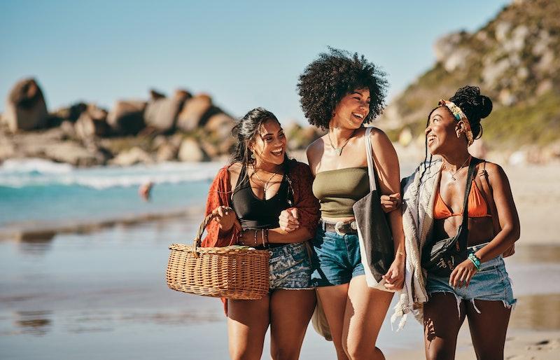 Women at the beach in the sun