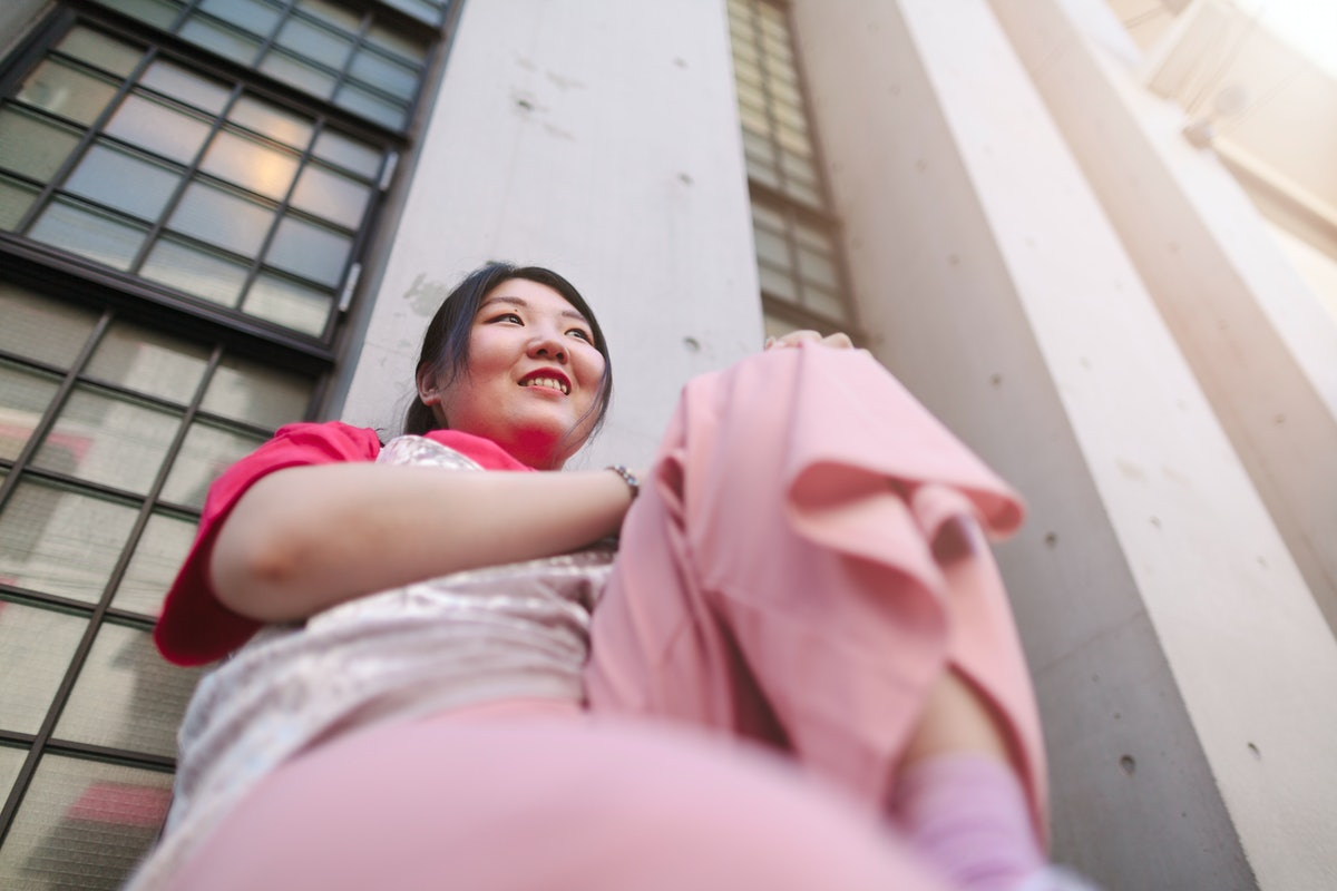Smiling young woman wearing all pink, having the best time during the June 2021 full moon.