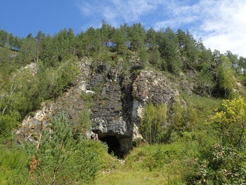 Entrance to Denisova cave in mountains